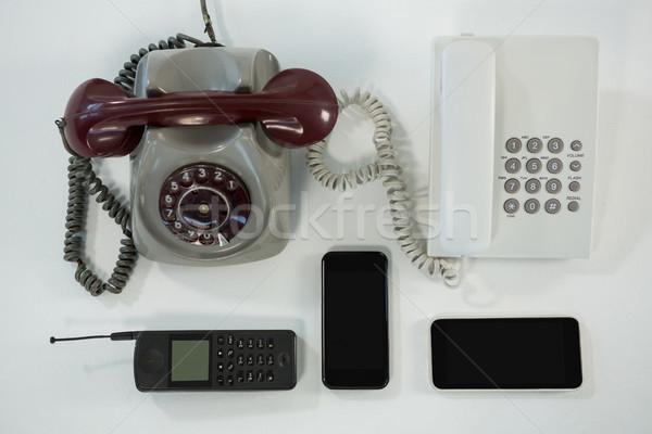öreg modern technológia asztal toll telefon Stock fotó © wavebreak_media