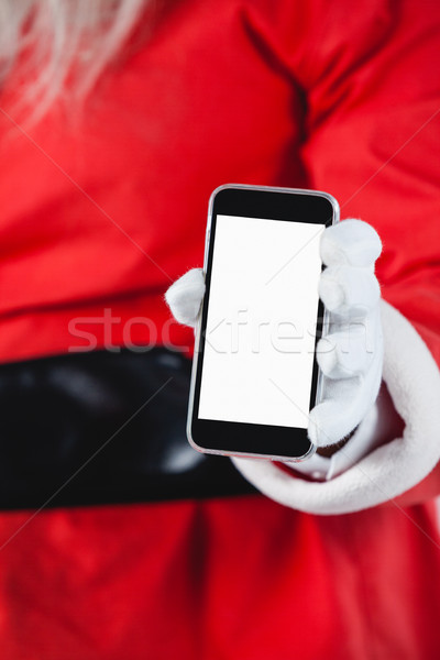 Santa claus showing mobile phone against white background Stock photo © wavebreak_media