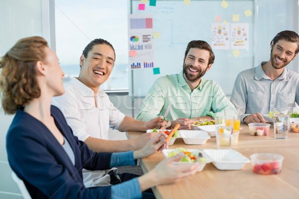 Glimlachend business maaltijd kantoor vrouw Stockfoto © wavebreak_media
