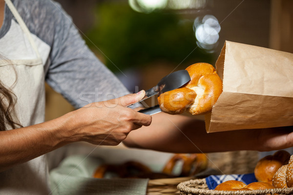 Staff packing bread in paper bag at bakery shop Stock photo © wavebreak_media