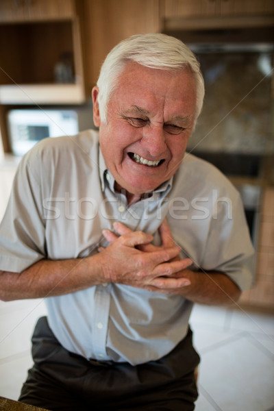 Senior man suffering from heart attack in the kitchen Stock photo © wavebreak_media
