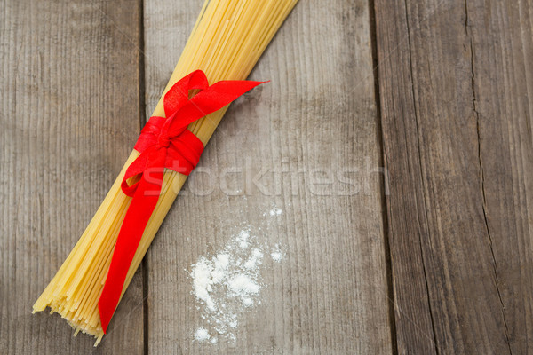 Bundle of raw spaghetti and flour Stock photo © wavebreak_media