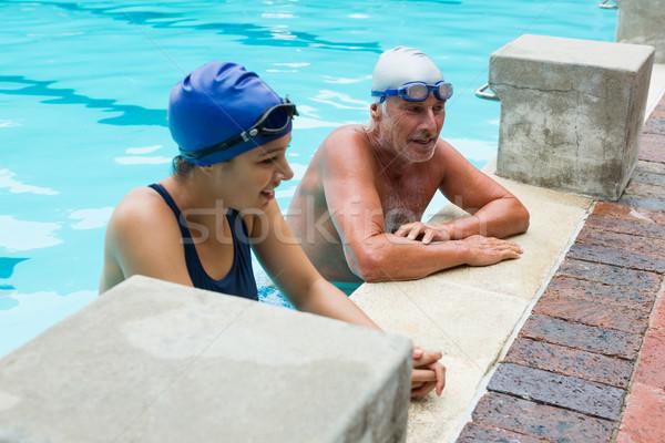 Senior man interacting with woman at poolside Stock photo © wavebreak_media