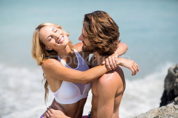 Young couple embracing against sea Stock photo © wavebreak_media