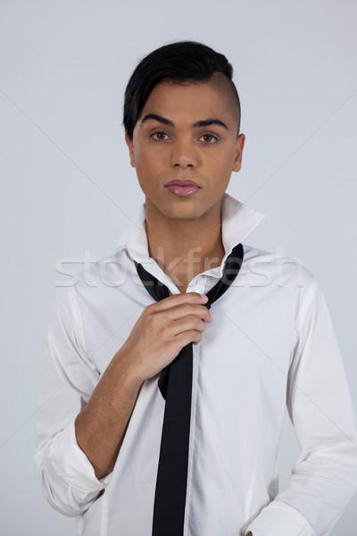 Portrait of transgender female holding tie Stock photo © wavebreak_media