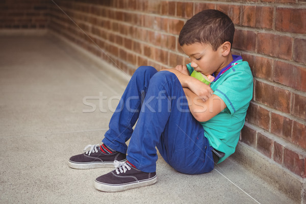 Stock photo: Upset lonely child sitting by himself