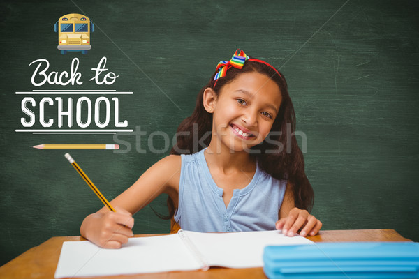 Stock photo: Composite image of pupil at her desk