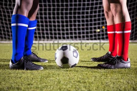 Football player in white kicking against united states of america flag Stock photo © wavebreak_media
