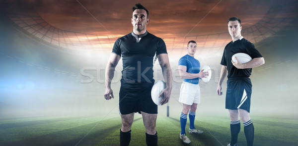 Composite image of rugby player holding rugby ball Stock photo © wavebreak_media