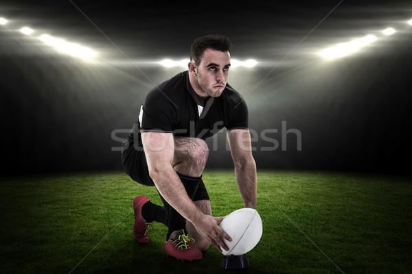 Composite image of rugby player getting ready to kick ball Stock photo © wavebreak_media