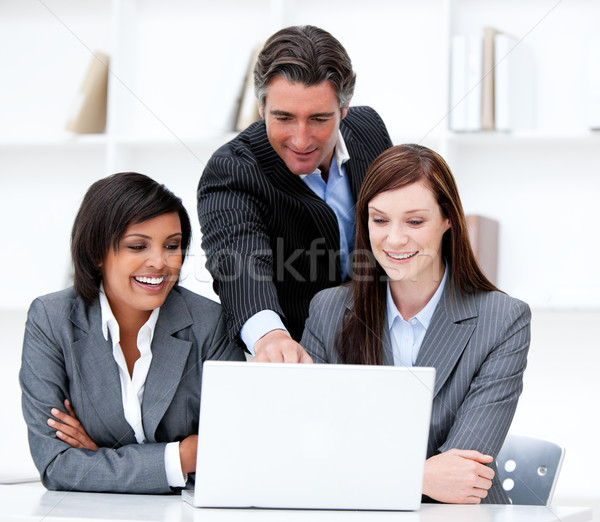 Stock photo: Multi-ethnic business team working at a computer