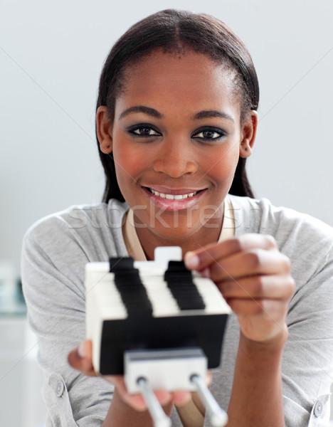 Charming ethnic businesswoman holding a business card holder  Stock photo © wavebreak_media
