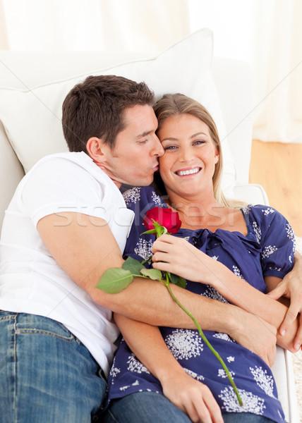 Afetuoso homem beijando esposa sofá casa Foto stock © wavebreak_media