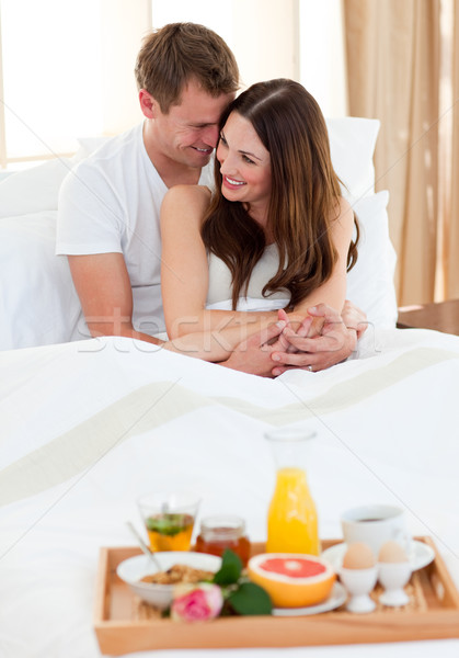 Intimate couple having breakfast lying in bed Stock photo © wavebreak_media