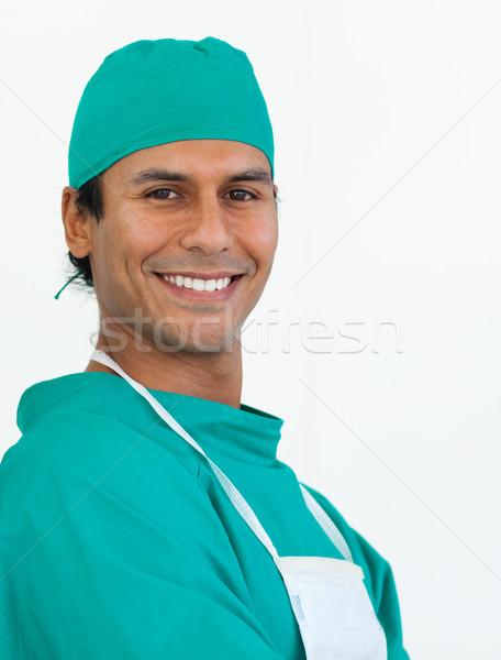 Retrato atraente cirurgião sorridente câmera homem Foto stock © wavebreak_media