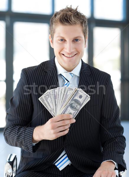 Işadamı dolar genç iş temas Stok fotoğraf © wavebreak_media