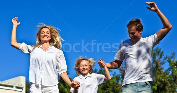 Happy family jumping in the air Stock photo © wavebreak_media