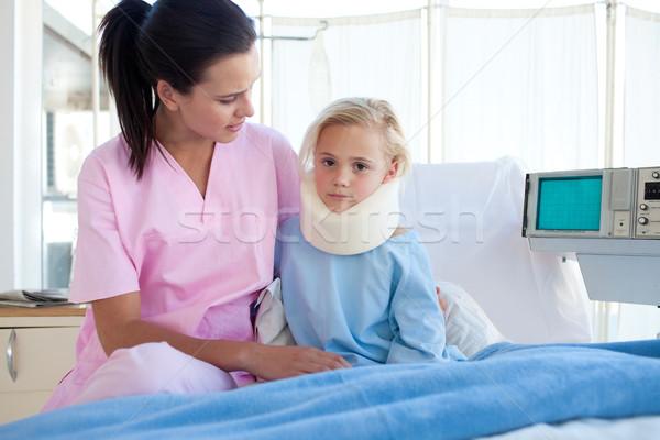 Nővér néz nyak lány orvos egészség Stock fotó © wavebreak_media