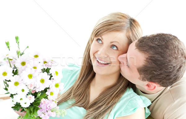 Caring man giving a bouquet to his girlfriend  Stock photo © wavebreak_media