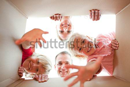 Happy family unpacking boxes in their new house Stock photo © wavebreak_media