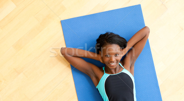Smiling woman doing fitness Stock photo © wavebreak_media