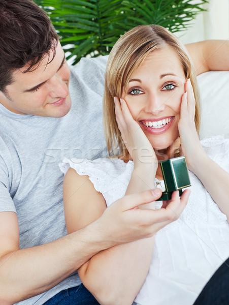 Femme étonné copain présente sourire maison Photo stock © wavebreak_media