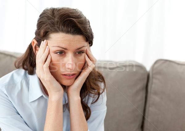 Tired businesswoman having a headache on the sofa at home Stock photo © wavebreak_media