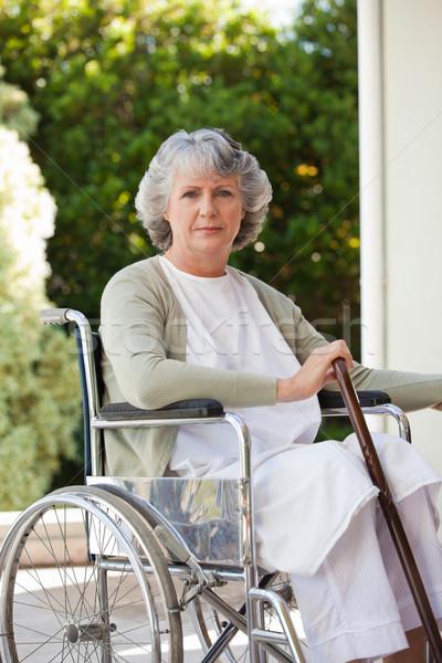 Senior woman in her wheelchair at home Stock photo © wavebreak_media