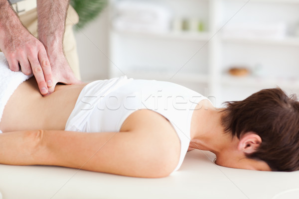 A chiropractor is massaging a woman Stock photo © wavebreak_media