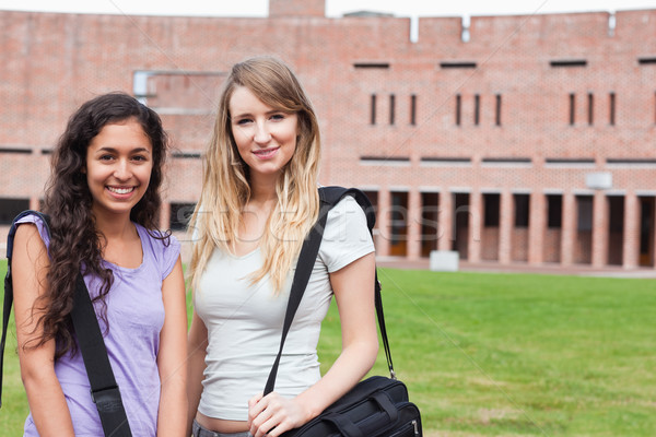 Smiling female students posing outside a building Stock photo © wavebreak_media