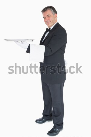 Portrait of a smiling businessman pointing at something against a white background Stock photo © wavebreak_media