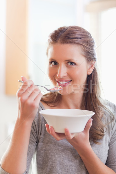 Young woman having some cereals for breakfast Stock photo © wavebreak_media