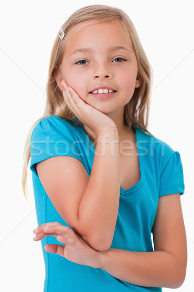 Portrait of a cute girl posing against a white background Stock photo © wavebreak_media