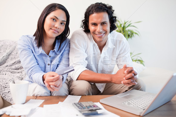 Young couple doing online banking in the living room Stock photo © wavebreak_media