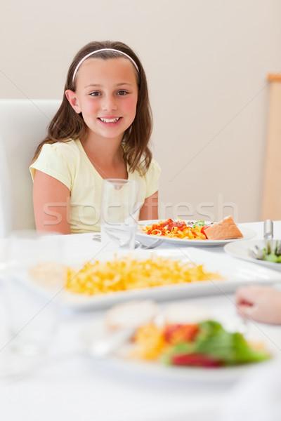 Gülen kız oturma yemek masası salata mutluluk Stok fotoğraf © wavebreak_media
