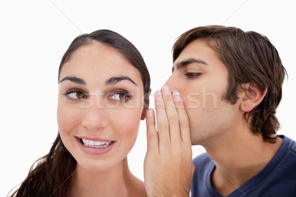 Man whispering something to his fiance against a white background Stock photo © wavebreak_media
