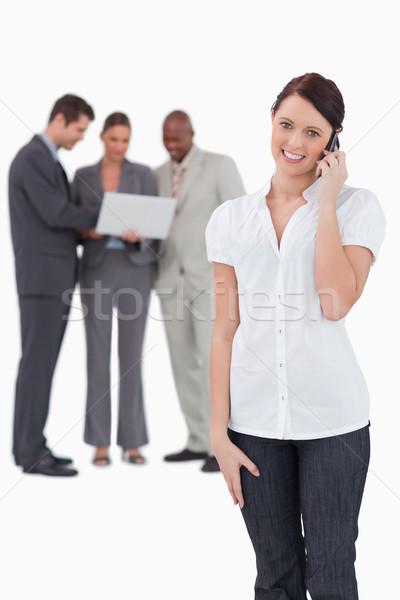 Verkoopster achter telefoon witte glimlach Stockfoto © wavebreak_media