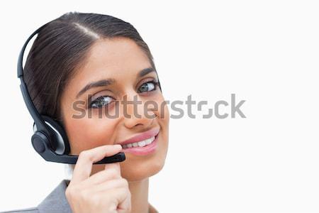 Sorridente call center agente fone branco telefone Foto stock © wavebreak_media