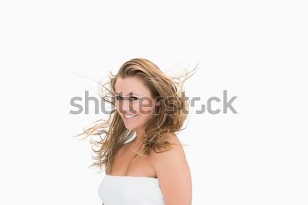Mulher cama sorridente olhando em linha reta à frente Foto stock © wavebreak_media