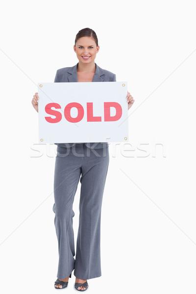 Felice agente immobiliare venduto segno bianco Foto d'archivio © wavebreak_media