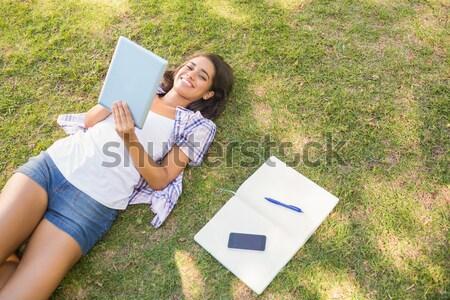 Kadın yan dizüstü bilgisayar kullanıyorsanız lies çim Stok fotoğraf © wavebreak_media