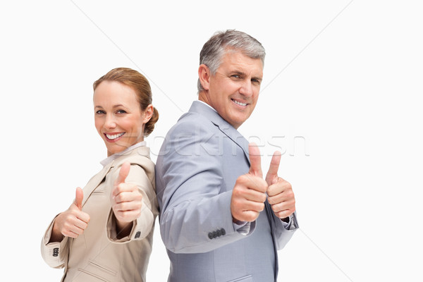 Portrait of business people approving back to back against white background Stock photo © wavebreak_media