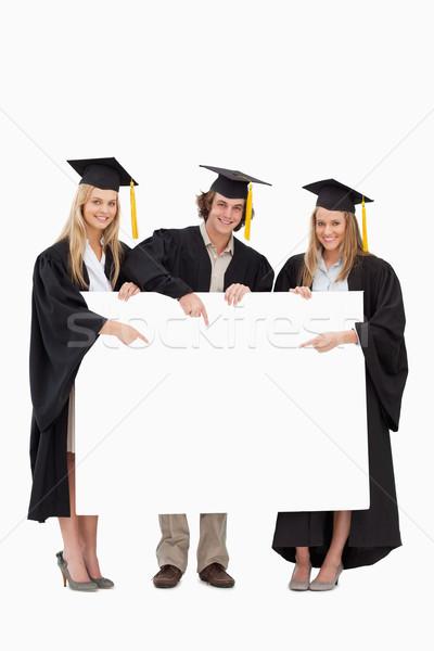 Három diákok diplomás köntös tart mutat Stock fotó © wavebreak_media