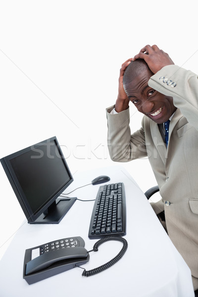 Side view of a furious businessman using a monitor against white background Stock photo © wavebreak_media