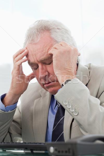 Retrato esgotado senior gerente dor de cabeça escritório Foto stock © wavebreak_media