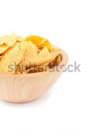 Wooden bowl full of crisps against white background Stock photo © wavebreak_media