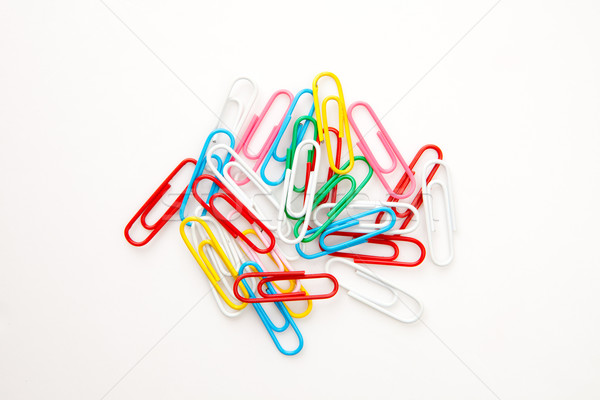 Large group of muti coloured paperclips against a white background Stock photo © wavebreak_media