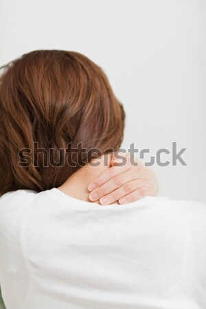 Close up of a brunette woman massing her neck in a room Stock photo © wavebreak_media