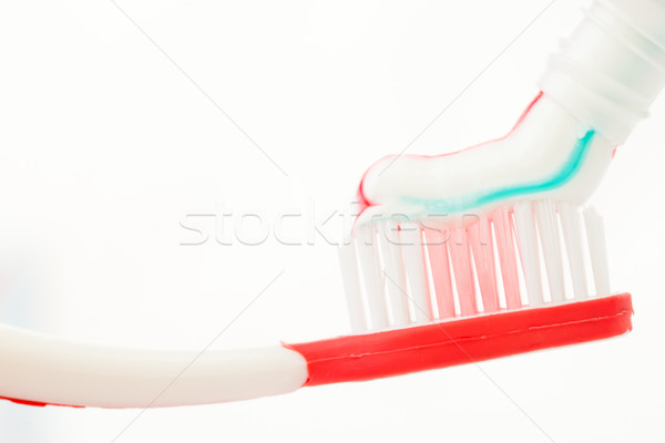 Red toothbrush with multicolour toothpaste Stock photo © wavebreak_media