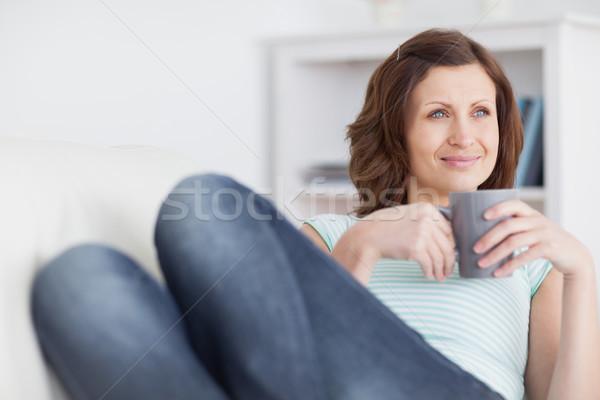 женщину кружка гостиной глазах Сток-фото © wavebreak_media